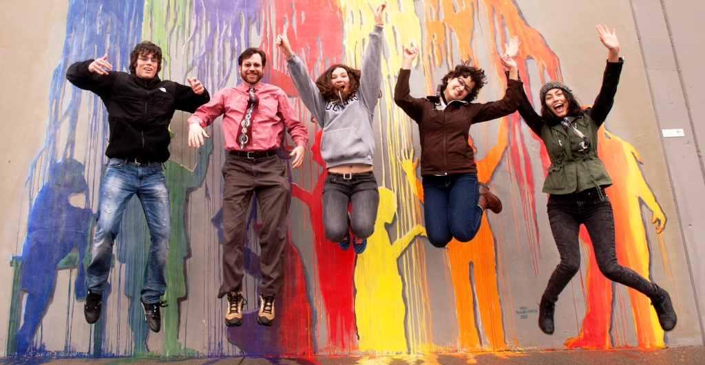Conor O'Donoghue, Professor Andy Jones, Annie Ashmore, Janet Sandoval, and Sabrina Sanchez do a jump photo during art scavenger hunt with the Professor Andy Jones' Cultural Offering of the City of Davis on Friday February 28, 2014 in Davis, CA.  Four teams of four looked for art in downtown Davis.